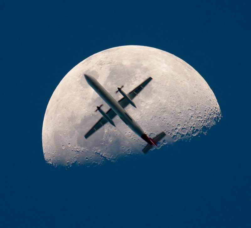 airplane passing the mooon perfect timing