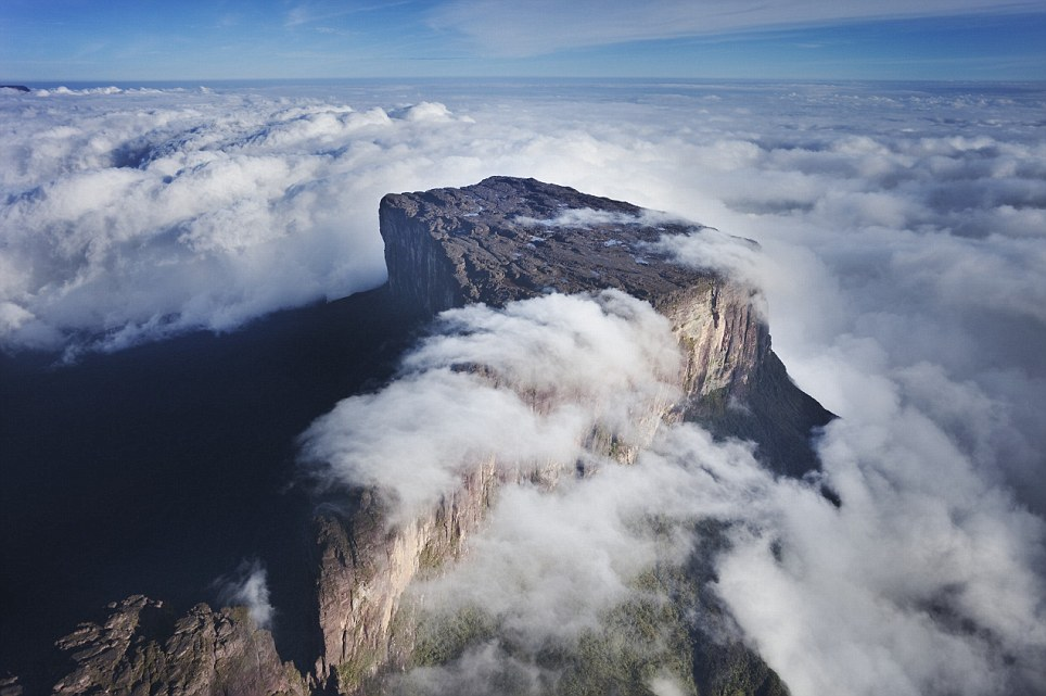 Mount Roraima is the highest tepui reaching 2810 meters in elevation. These cloud covered flat top mountains are considered to be some of the oldest geological formations on Earth. --- Image by © Martin Harvey/Corbis